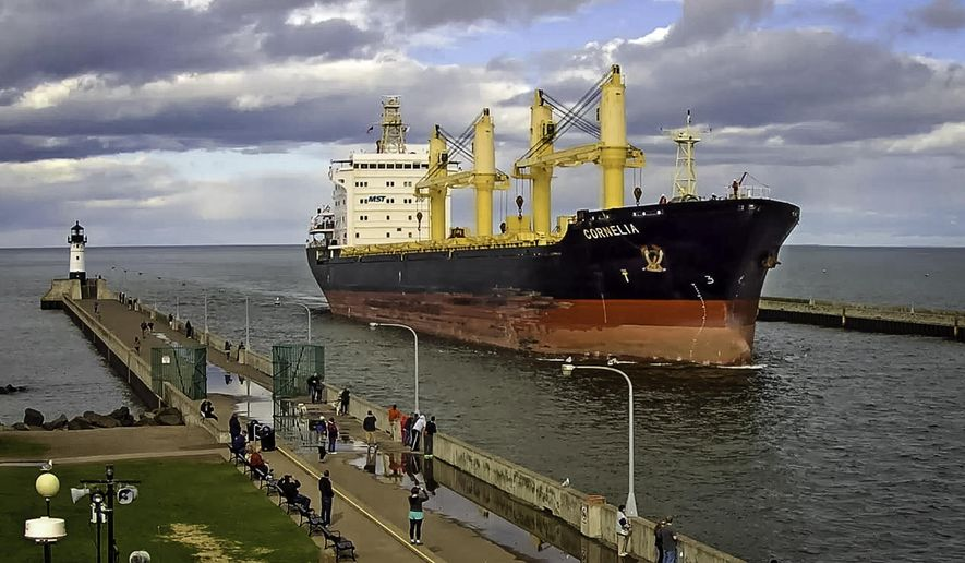 """In this photo taken May 12, 2015 and provided by the Lake Superior Maritime Visitors Center, the German-operated ship Cornelia enters the harbor in Duluth, Minn. The Liberian-flagged cargo ship and crew have been stuck at anchor outside the Lake Superior port of Duluth for close to a month for unspecified environmental violations and there's no resolution in sight despite the upcoming closure of the St. Lawrence Seaway for the winter, officials said Wednesday, Dec. 2, 2015. (Dennis O""""Hara/Lake Superior Maritime Visitors Center via AP)"""