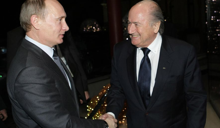 FILE - In this Thursday, Dec. 2, 2010 file photo Russian Prime Minister Vladimir Putin, left, shakes hands with FIFA President Joseph Blatter after Russia was announced as the host for the 2018 soccer World Cup in Zurich, Switzerland.  On Dec. 2, 2010, five years ago, a widely discredited FIFA executive committee chose Russia to host the 2018 World Cup and gave the 2022 tournament to Qatar, an outcome which was tainted by corruption allegations even before the vote. (AP Photo/Alexei Nikolsky, pool, FILE)