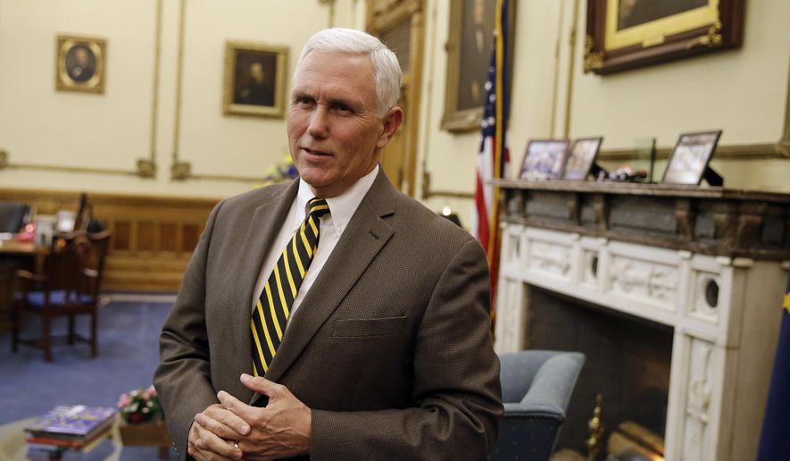 Indiana Gov. Mike Pence speaks after a meeting with Indianapolis Archbishop Joseph Tobin at the Statehouse Wednesday, Dec. 2, 2015, in Indianapolis, a day after the archdiocese said it has the means to resettle a Syrian refugee family bound for the state. Pence blocked state agencies from distributing federal money for Syrian refugees following the deadly Paris attacks.  (AP Photo/Darron Cummings)