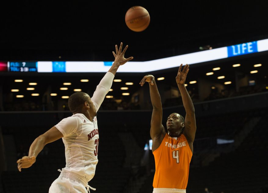 Tennessee guard Robert Hubbs III (3) takes a shot over Nebraska forward Ed Morrow (30) during the first half of an NCAA college basketball game in the consolation game at the Barclays Center Classic. Saturday, Nov. 28, 2015, in New York.  (AP Photo/Bryan R. Smith)