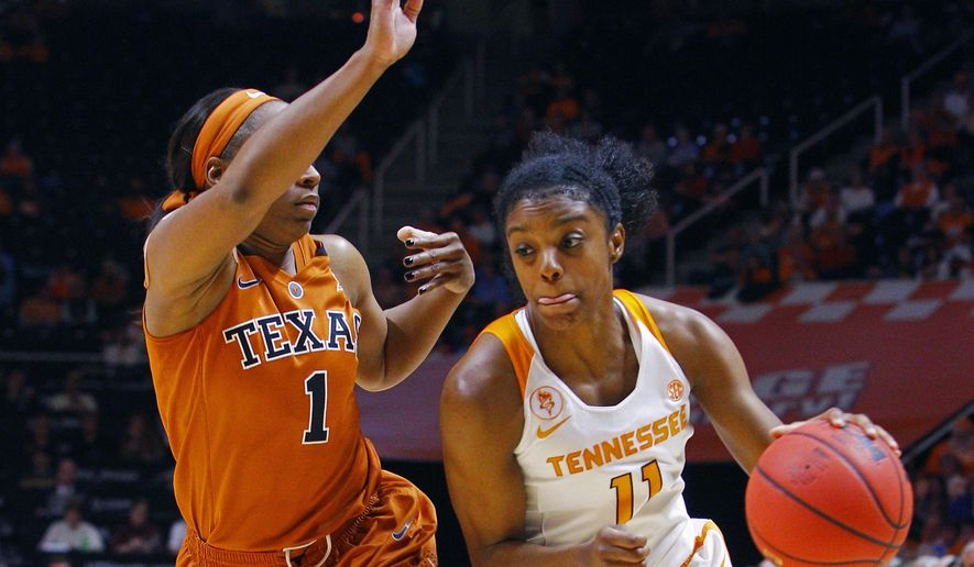 Tennessee guard Diamond DeShields (11) drives against Texas guard Empress Davenport (1) in the second half of an NCAA college basketball game, Sunday, Nov. 29, 2015, in Knoxville, Tenn. Texas won 64-53. (AP Photo/Wade Payne)