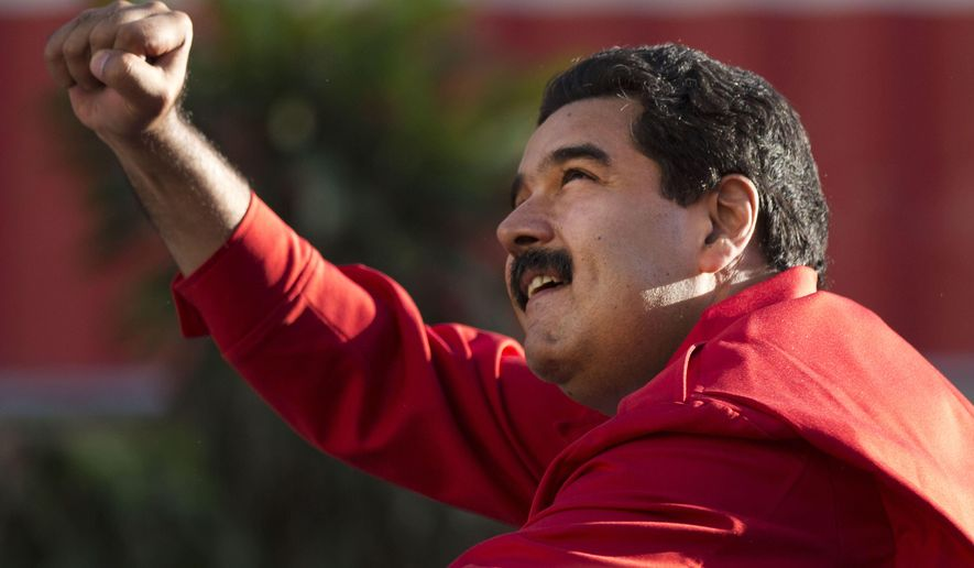 Venezuela's President Nicolas Maduro gestures to supporters from the top of a car after the inauguration of cable car public transportation system, in the popular neighborhood of Petare, in Caracas, Venezuela, Tuesday, Dec. 1, 2015. As the country heads to congressional elections on Sunday, the opposition might gain control of the National Assembly for the first time since 1998, and serve the socialist party founded by late President Hugo Chavez its first ever loss in a nationwide contest for public office. (AP Photo/Ariana Cubillos)