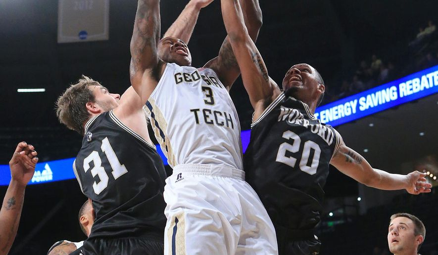 Georgia Tech guard Marcus Georges-Hunt battles Wofford defenders CJ Neumann, left, and Jaylen Allen for a rebound during an NCAA college basketball game Tuesday, Dec. 1, 2015, in Atlanta. (Curtis Compton/Atlanta Journal-Constitution via AP)  MARIETTA DAILY OUT; GWINNETT DAILY POST OUT; LOCAL TELEVISION OUT; WXIA-TV OUT; WGCL-TV OUT; MANDATORY CREDIT