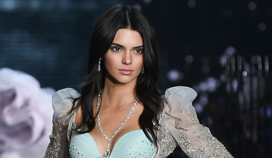 FILE - In this Nov. 10, 2015, file photo, model Kendall Jenner walks the runway during the 2015 Victoria's Secret Fashion Show at the Lexington Armory in New York. (Photo by Evan Agostini/Invision/AP, File)
