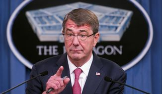 While ordering the U.S. military to open all combat jobs to women, Defense Secretary Ashton Carter said there would be no lowering of standards between the genders in active service roles. (Associated Press)