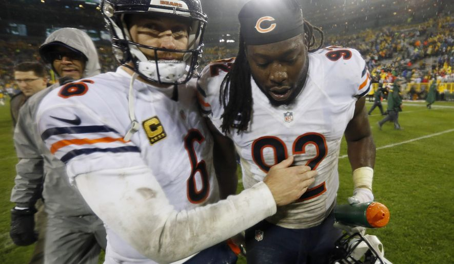 FILE - In this Nov. 26, 2015 file photo, Chicago Bears' Jay Cutler (6) and Pernell McPhee (92) celebrate their 17-13 win over the Green Bay Packers in Green Bay, Wis. The Chicago Bears are winning at a rate few would have envisioned, and they sure are having a good time doing it. Now, after beating the Packers for just the second time in eight games at Lambeau Field, Chicago will try to keep the party going when they host the struggling San Francisco 49ers on Sunday, Dec. 6. (AP Photo/Mike Roemer, File)