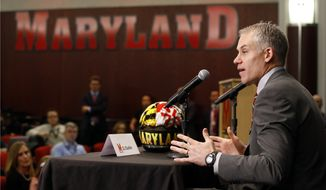 D.J. Durkin speaks at a news conference after being introduced as the new head football coach at the University of Maryland, Thursday, Dec. 3, 2015, in College Park, Md. Durkin comes from the University of Michigan, where he was the defensive coordinator and linebackers coach. (AP Photo/Patrick Semansky)