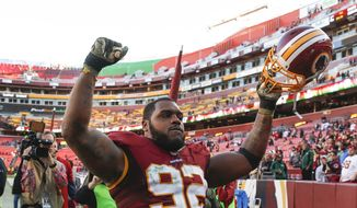 Washington Redskins defensive end Chris Baker (92) celebrates as he walks off the field after an NFL football game against theNew Orleans Saints in Landover, Md., Sunday, Nov. 15, 2015. The Redskins defeated the New Orleans Saints 47-14. (AP Photo/Evan Vucci)