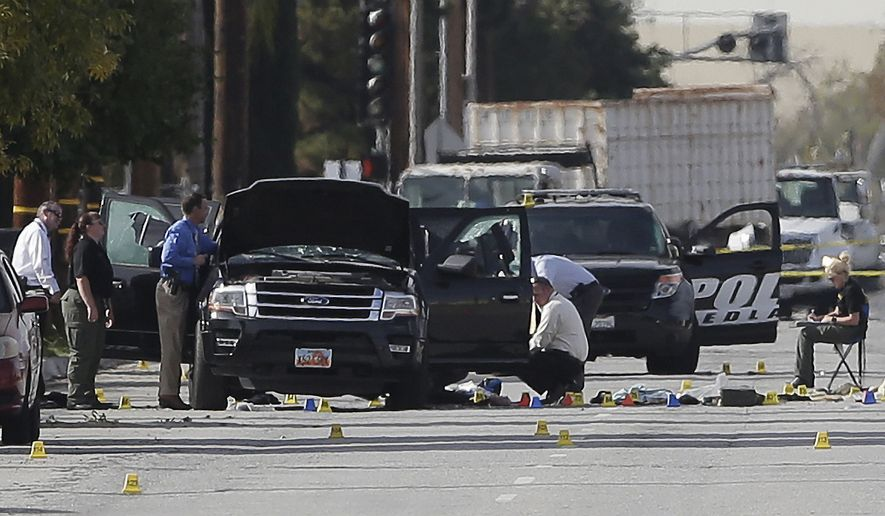 Authorities investigate the scene Thursday, Dec. 3, 2015, in San Bernardino, Calif., where a police shootout with suspects took place.  A heavily armed man and woman opened fire Wednesday on a holiday banquet, killing multiple people and seriously wounding others in a precision assault, authorities said. Hours later, they died in a shootout with police. (AP Photo/Chris Carlson)