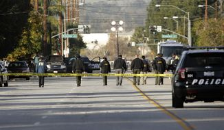 Investigators search for bullet casings at the scene where Wednesday's police shootout with suspects took place, Thursday, Dec. 3, 2015, in San Bernardino, Calif. A heavily armed man and woman dressed for battle opened fire on a holiday banquet for his co-workers Wednesday, killing multiple people and seriously wounding others in a precision assault, authorities said. Hours later, they died in a shootout with police.(AP Photo/Jae C. Hong)