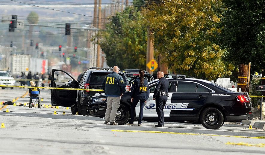 FBI, San Bernardino City and San Bernardino County Sheriff's officials continue documenting and investigating on Thursday, Dec. 3, 2015, the scene of the shootout between law enforcement officials and the mass shooting suspects which occurred on Wednesday. (James Quigg/The Victor Valley Daily Press via AP) MANDATORY CREDIT