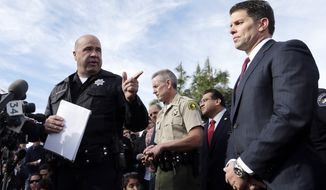 San Bernardino Police Chief Jarrod Burguan, left, introduces David Bowditch, assistant director in charge of the FBI LA Field Office, at a press conference near the site of yesterday's mass shooting on Thursday, Dec. 3, 2015 in San Bernardino, Calif. A heavily armed man and woman dressed for battle opened fire on a holiday banquet for his co-workers Wednesday, killing multiple people and seriously wounding others in a precision assault, authorities said. Hours later, they died in a shootout with police. (AP Photo/Chris Carlson)
