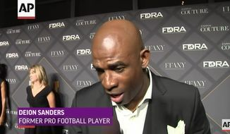 NFL legend Deion Sanders said people, not guns are to blame for Wednesday's mass shooting that claimed 14 lives in San Bernardino, California. (YouTube/@Associated Press)