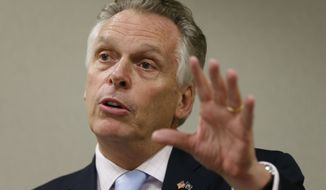 Virginia Gov. Terry McAuliffe speaks during an AP Day at the Capitol session in Richmond, Va., Thursday, Dec. 3, 2015.  (AP Photo/Steve Helber)