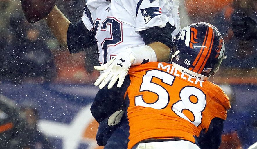 New England Patriots quarterback Tom Brady (12) is sacked by Denver Broncos outside linebacker Von Miller (58) during the second half of an NFL football game, Sunday, Nov. 29, 2015, in Denver. The Broncos defeated the Patriots 30-24. (AP Photo/Jack Dempsey)