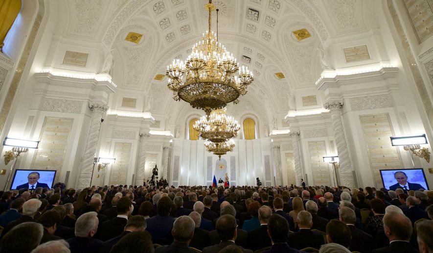Russian President Vladimir Putin gives his annual state of the nation address in the Kremlin in Moscow, Russia, Thursday, Dec. 3, 2015. Putin called Thursday for a broad international front against terrorism and accused Turkey of trading oil with the Islamic State group. (AP Photo/Ivan Sekretarev)