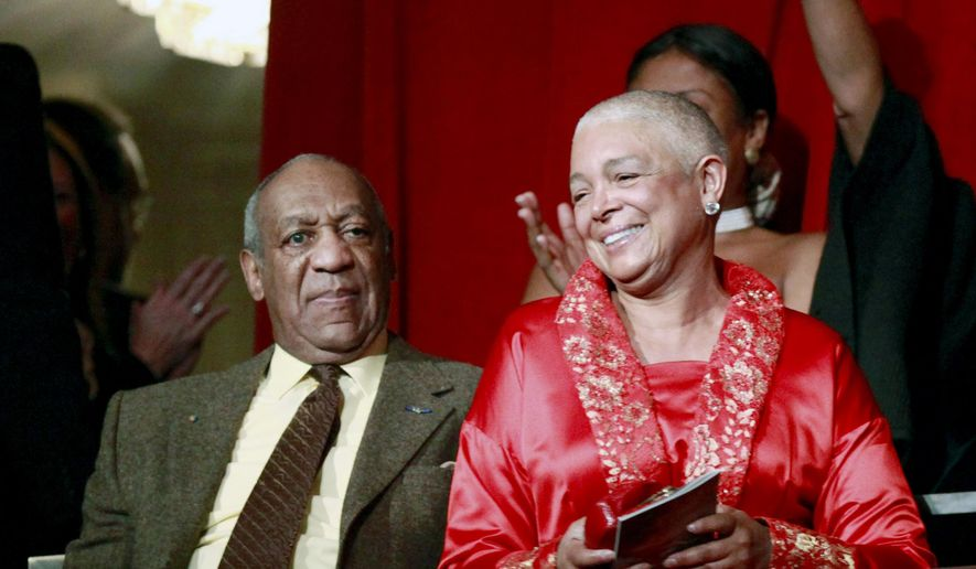 Bill Cosby, left, and his wife Camille appear at the John F. Kennedy Center for Performing Arts before Bill Cosby received the Mark Twain Prize for American Humor in Washington, in this Oct. 26, 2009, file photo. (AP Photo/Jacquelyn Martin, File)