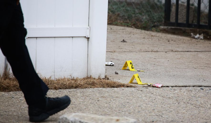 Police investigate the scene where a 4-year-old that was mauled by four dogs, Wednesday, Dec. 2, 2015, in Detroit. (Ryan Garza/Detroit Free Press via AP)  DETROIT NEWS OUT; TV OUT; MAGS OUT; NO SALES; MANDATORY CREDIT DETROIT FREE PRESS