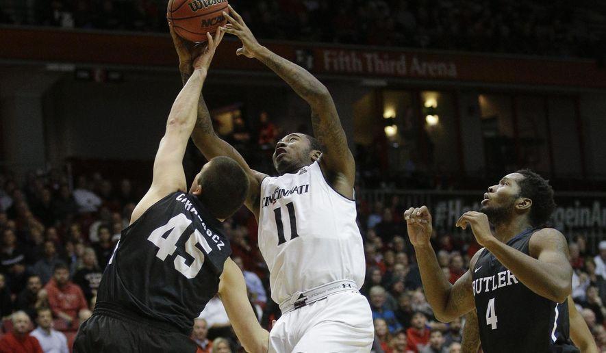 Butler's Andrew Chrabascz (45) blocks a shot by Cincinnati's Gary Clark (11) in the first half of an NCAA college basketball game, Wednesday, Dec. 2, 2015, in Cincinnati. (AP Photo/John Minchillo)