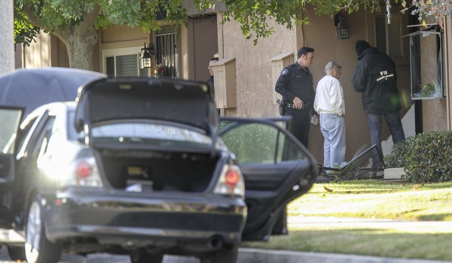 FBI agents interview a man, center, outside a home in connection to the shootings in San Bernardino, Thursday, Dec. 3, 2015, in Redlands, Calif. A heavily armed man and woman opened fire Wednesday on a holiday banquet for his co-workers, killing multiple people and seriously wounding others in a precision assault, authorities said. Hours later, they died in a shootout with police. (AP Photo/Ringo H.W. Chiu) ** FILE **