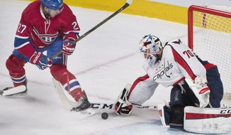 Washington Capitals goaltender Braden Holtby (70) makes a save against Montreal Canadiens' Alex Galchenyuk during the second period of an NHL hockey game Thursday, Dec. 3, 2015, in Montreal. (Graham Hughes/The Canadian Press via AP)
