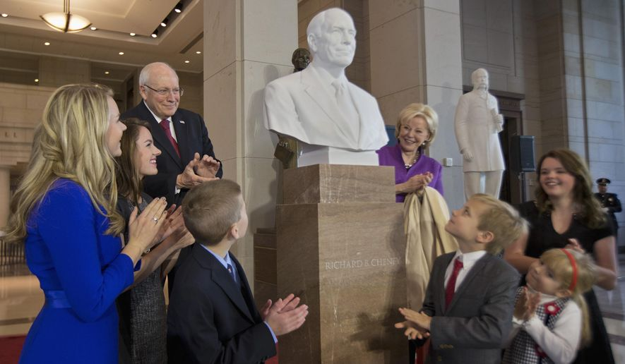Former Vice President Dick Cheney, back left, his wife Lynne Cheney, back right, and their grandchildren applaud as his marble bust is unveiled in the Emancipation Hall on Capitol Hill in Washington, Thursday, Dec. 3, 2015. Congressional leaders and former President George W. Bush paid tribute to Cheney, who also served as congressman from Wyoming.  (AP Photo/Manuel Balce Ceneta)