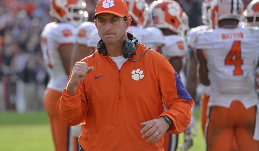 FILE - In this Nov. 28, 2015 file photo, Clemson head coach Dabo Swinney reacts in the closing minutes of an NCAA college football game against South Carolina in Columbia,  S.C.  Swinney is three victories away from winning a national championship. (AP Photo/Richard Shiro)