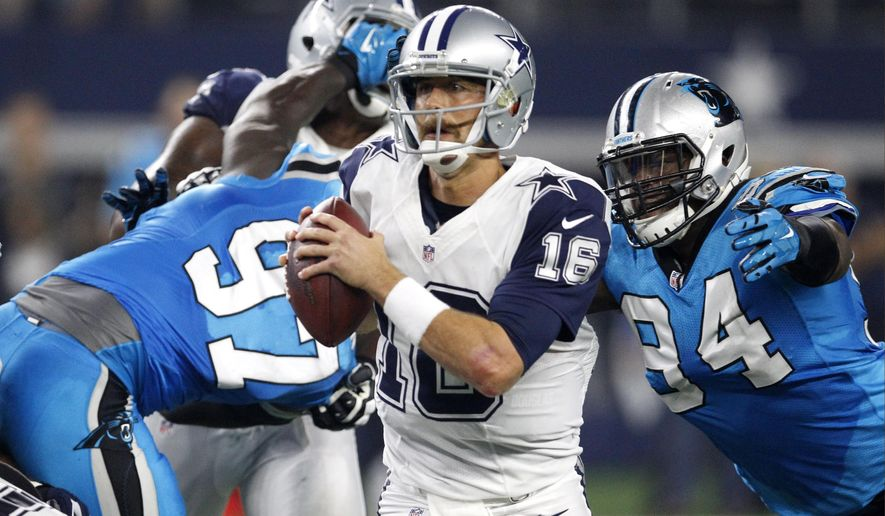 FILE - In this Nov. 26, 2015 file photo, Dallas Cowboys quarterback Matt Cassel (16) scrambles out of the pocket under pressure from Carolina Panthers defensive end Kony Ealy (94) during the second half of an NFL football game in Arlington, Texas. It's back to the backup in Matt Cassel for the Cowboys after Tony Romo's second left collarbone break this year, the latter a season-ending injury. Cassel was 0-4 filling in for Romo the first time.(AP Photo/Brandon Wade)