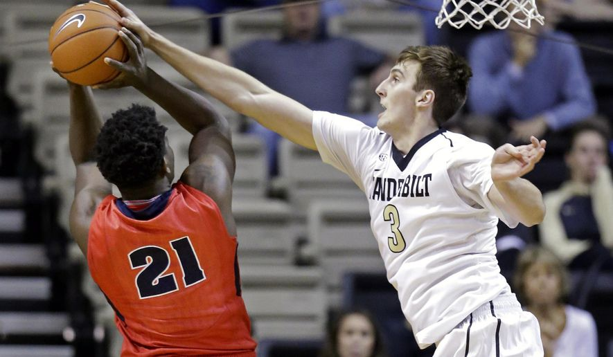Vanderbilt forward Luke Kornet (3) blocks a shot attempt by Detroit forward Jaleel Hogan (21) in the first half of an NCAA college basketball game Wednesday, Dec. 2, 2015, in Nashville, Tenn. (AP Photo/Mark Humphrey)