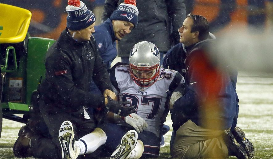 FILE - In this Nov. 29, 2015, file photo, New England Patriots tight end Rob Gronkowski (87) is attended to after getting injured during the second half of an NFL football game against the Denver Broncos in Denver. Tom  Brady won't have receiver Julian Edelman and All-Pro tight end Rob Gronkowski is expected to be out because of injuries on Sunday agains the Eagles, but Brady makes everyone around him better. (AP Photo/Jack Dempsey)