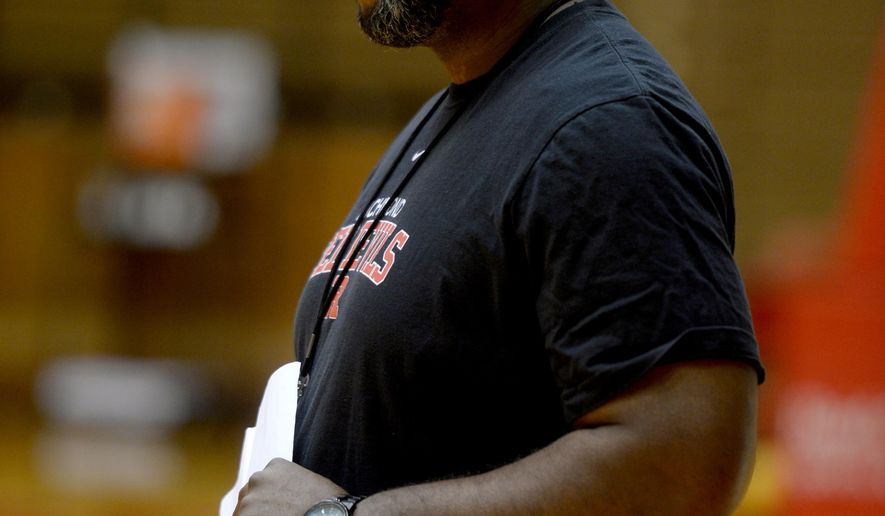 In this photo taken on Nov. 18, 2015, Richmond High School boys basketball coach Rick Wedlow keenly watches practice at the Tiernan Center, in Richmond, Ind. Dealing with adversity, Wedlow grew up in a single-parent household in Gary, but he was able to escape that difficult  ife and is starting his first season as head coach of the Richmond High School boys basketball team. (Joshua Smith/The Palladium-Item via AP)  NO SALES; MANDATORY CREDIT