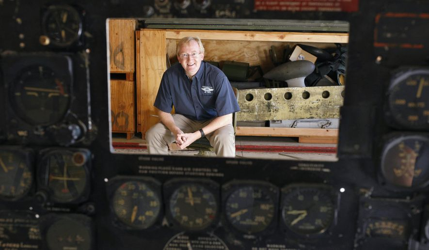 ADVANCE FOR MONDAY, DEC. 7 AND THEREAFTER - In a Nov. 19, 2015 photo, Commemorative Air Force executive director Adam Smith poses in front of parts used to restore the C-47 that led the D-Day invasion, in Dallas. The C-47 will be an anchor airplane for the CAF museum at Dallas Executive Airport planned to open by the end of the decade. (Nathan Hunsinger/The Dallas Morning News via AP)