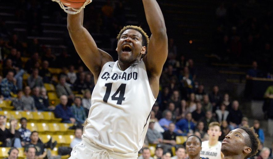 Colorado's Tory Miller dunks the ball over Fort Lewis' Kofi Josephs during an NCAA college basketball game on Wednesday, Dec. 2, 2015 at the Coors Event Center on the CU campus in Boulder, Colo. (Jeremy Papasso/The Daily Camera via AP)