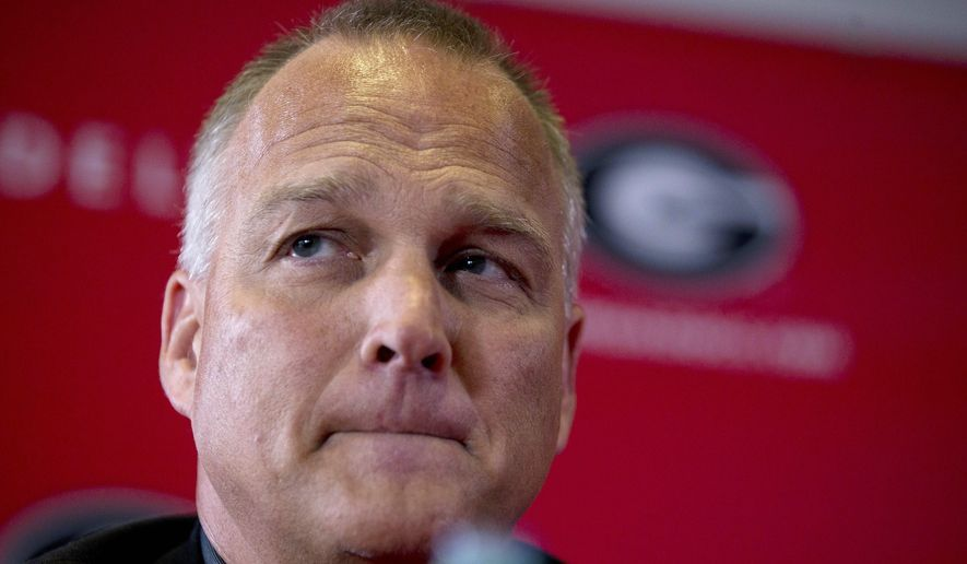 FILE - In this Nov. 30, 2015, file photo, Georgia head football coach Mark Richt listens to a question during a news conference Monday, Nov. 30, 2015, in Athens, Ga. Richt, the former Miami quarterback, has reached a tentative agreement to be the Hurricanes' next head coach, pending the completion of contract talks, a person with knowledge of the negotiations told The Associated Press. The person spoke Wednesday, Dec. 2, on condition of anonymity because the deal has not been signed and the university has not announced the hire publicly. (AP Photo/John Bazemore, File)