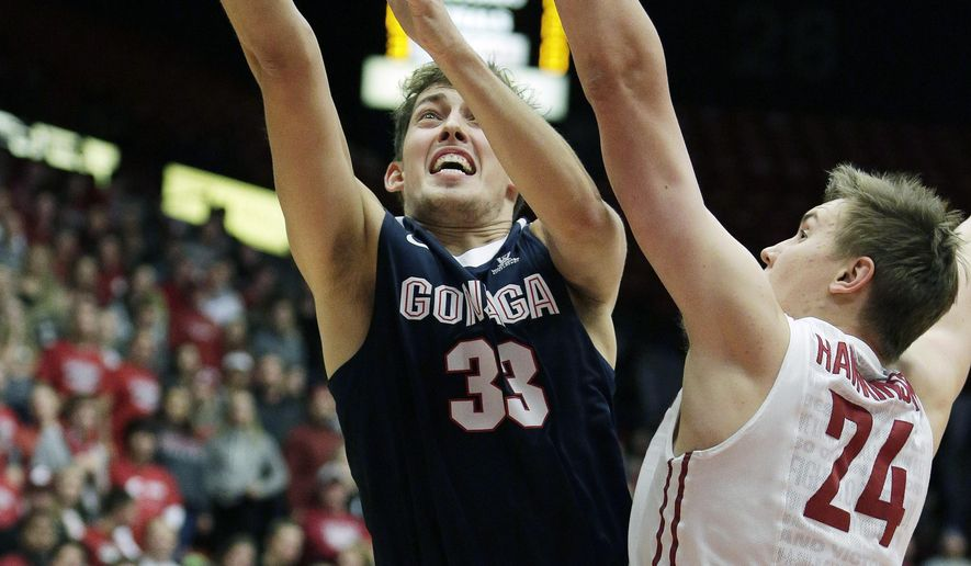 Gonzaga's Kyle Wiltjer (33) takes a shot while under pressure from Washington State's Josh Hawkinson (24) during the first half of an NCAA college basketball game, Wednesday, Dec. 2, 2015, in Pullman, Wash. (AP Photo/Young Kwak)