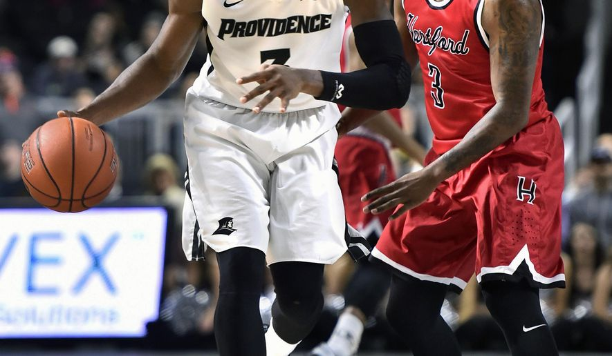 Providence guard Kris Dunn (3) controls the ball as Hartford guard Jalen Ross (3) defends during the second half of an NCAA college basketball game against Hartford, Wednesday, Dec. 2, 2015, in Providence, R.I.  Providence won 89-66. (AP Photo/Gretchen Ertl)