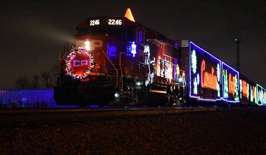 The Canadian Pacific Holiday Train, lit with bright blinking lights of reindeers, snowmen and Santa, rolled through Metro Detroit  rolled through Metro Detroit Wednesday, Dec. 2, 2015, traveling across the U.S. and Canada raising awareness for hunger across North America. (Tanya Moutzalias/The Grand Rapids Press/MLive.com  via AP) ALL LOCAL TELEVISION OUT; LOCAL TELEVISION INTERNET OUT; MANDATORY CREDIT
