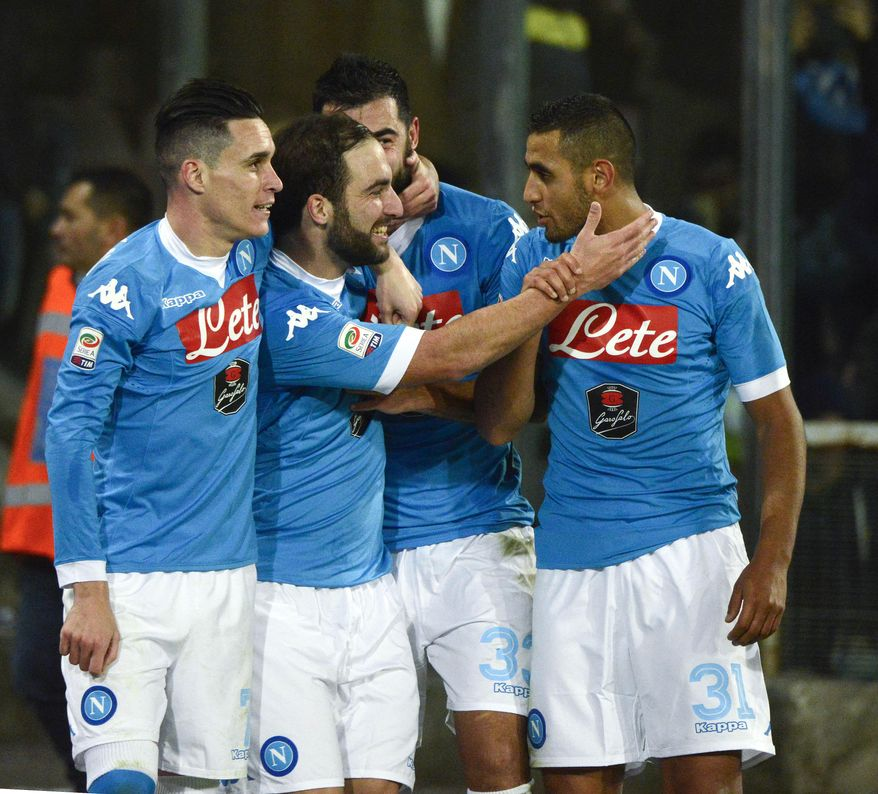 Napoli's Gonzalo Higuain, second from left, celebrates with his teammates after scoring his second goal during a Serie A soccer match between Napoli and Inter Milan, at the San Paolo stadium in Naples, Italy, Monday, Nov. 30, 2015. (AP Photo/Salvatore Laporta)