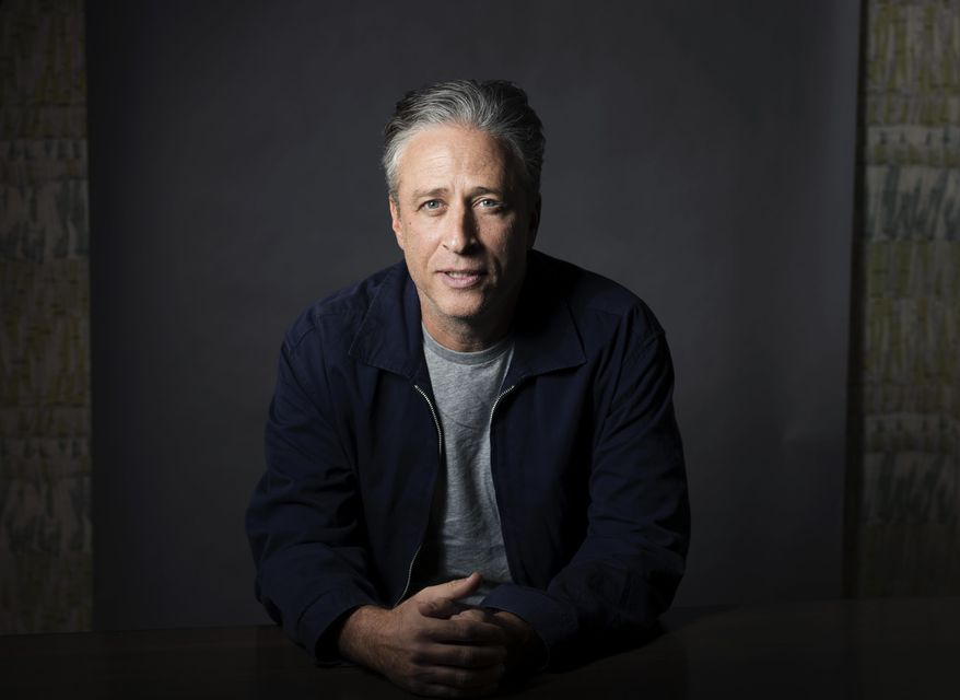 """In this Nov. 7, 2014 file photo, Jon Stewart poses in New York. Fresh from """"The Daily Show,"""" Stewart has signed on with HBO in an exclusive four-year production pact. HBO said Tuesday, Nov. 3, 2015, the partnership will start with short-form digital content to be showcased on HBO Now, HBO Go and other platforms.  — FILE (Photo by Victoria Will/Invision/AP, File)"""