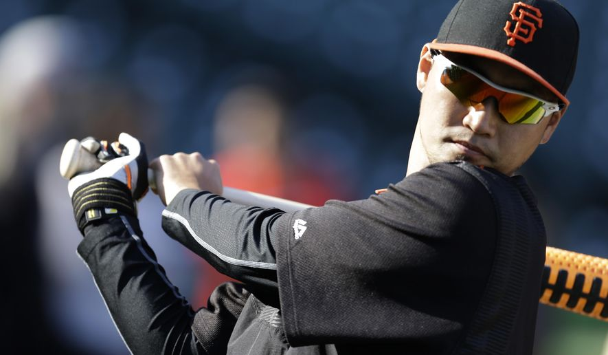 FILE - In this Wednesday, April 22, 2015 file photo, San Francisco Giants' Nori Aoki of Japan waits to bat during practice prior to a baseball game against the Los Angeles Dodgers in San Francisco. The Mariners kept up their offseason makeover on Thursday, Dec. 3, 2015 by finalizing a $5.5 million, one-year contract with free agent outfielder Nori Aoki, a deal that includes a $6 million conditional option for the 2017 season. (AP Photo/Ben Margot, File)