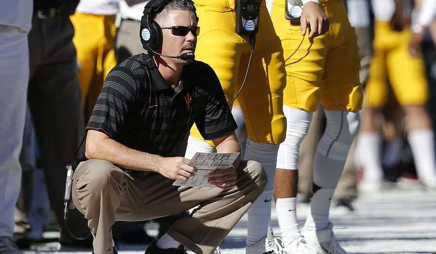 FILE - In this Nov. 28, 2014, file photo, Arizona State offensive coordinator Mike Norvell watches from the sidelines during the second half of an NCAA college football game against Arizona in Tucson, Ariz. A person with direct knowledge of the decision tells The Associated Press that Arizona State offensive coordinator Mike Norvell will be the new head coach at Memphis.  Norvell's expected to be introduced at news conference on Friday, Dec. 4, 2015, according to a person who spoke to the AP on condition of anonymity because the hiring hasn't been announced yet. (AP Photo/Rick Scuteri, File)