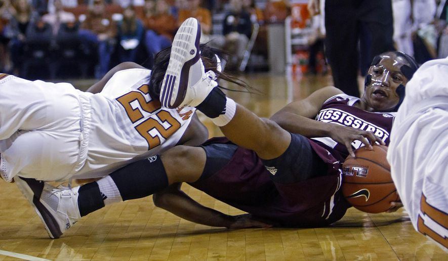 Mississippi State guard Morgan William looks to pass after recovering a loose ball during the first half of an NCAA college basketball game against Texas, Wednesday, Dec. 2, 2015, in Austin, Texas. (AP Photo/Michael Thomas)
