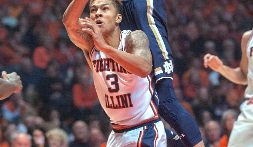 Notre Dame forward Zach Auguste (30) swats away a shot attempt by Illinois guard Khalid Lewis (3) in the first half of an NCAA College basketball game at the State Farm Center in Champaign, Ill., on Wednesday Dec. 2, 2015.  (AP Photo/Rick Danzl)