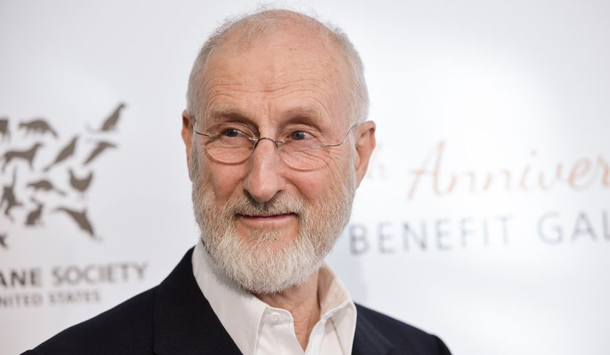 In this Saturday, March 29, 2014, file photo, actor James Cromwell arrives at The Humane Society Of The United States 60th Anniversary Benefit Gala on , in Beverly Hills, Calif. Cromwell was one of two people escorted from an upstate New York business event on Tuesday, Dec. 1, 2015, for protesting an award given to an energy company. (Photo by Richard Shotwell/Invision/AP, File)