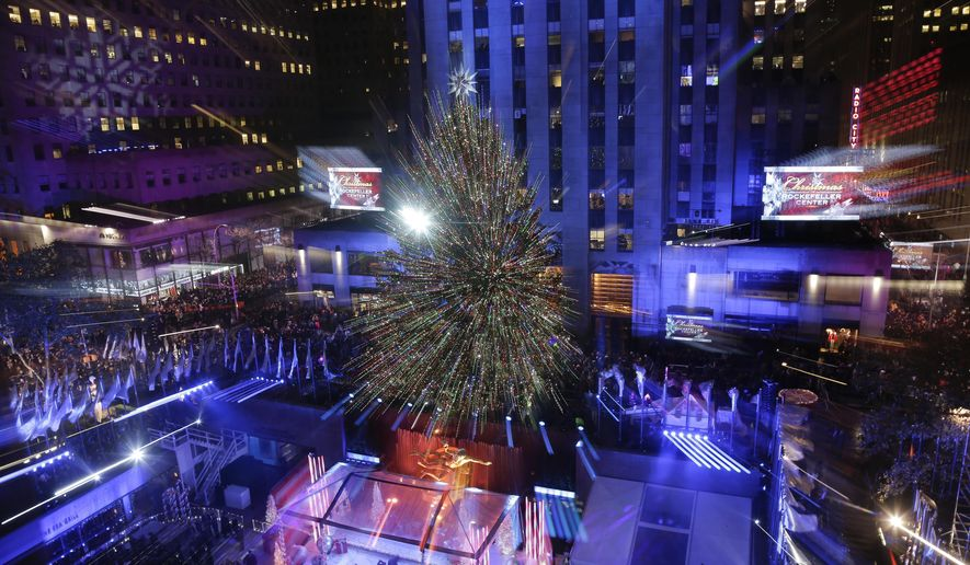 The Rockefeller Center Christmas tree stands lit during the lighting ceremony, Wednesday, Dec. 2, 2015, in New York. The Norway Spruce tree is lit with about 45,000 multi-colored LED lights. (AP Photo/Julie Jacobson)
