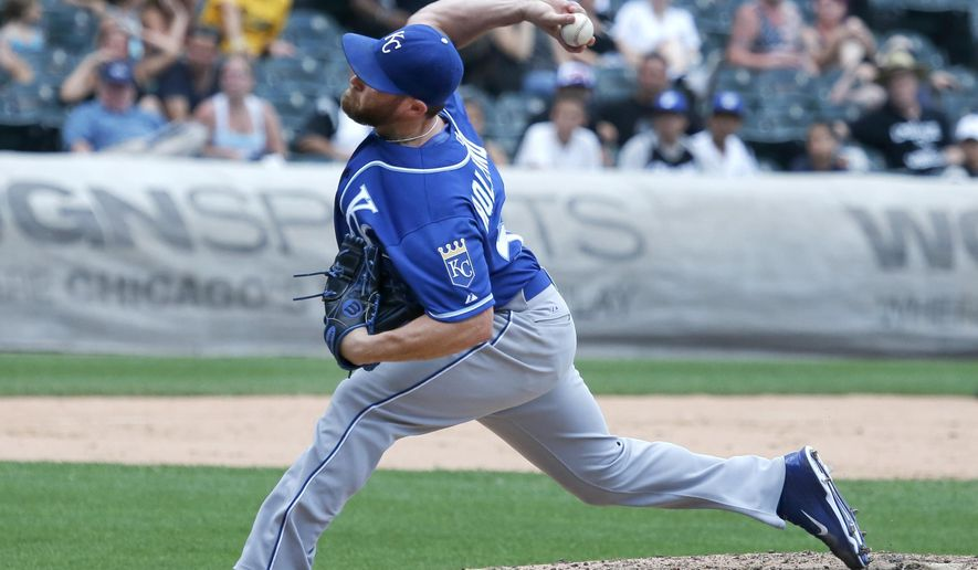 FILE - In this July 17, 2015, file photo, Kansas City Royals relief pitcher Greg Holland delivers during the ninth inning of a baseball game and Royals' 4-2 win over the Chicago White Sox in Chicago. The Royals declined to offer Holland a 2016 contract Wednesday, Dec. 2, making the former All-Star closer a free agent for the first time as he recovers from Tommy John surgery. (AP Photo/Charles Rex Arbogast, File)