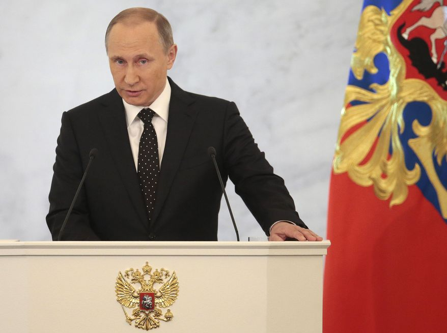 Russian President Vladimir Putin gives his annual state of the nation address in the Kremlin in Moscow, Russia, Thursday, Dec. 3, 2015. Putin says Russian military in Syria has been fighting for Russia's security. (AP Photo/Ivan Sekretarev) ** FILE **