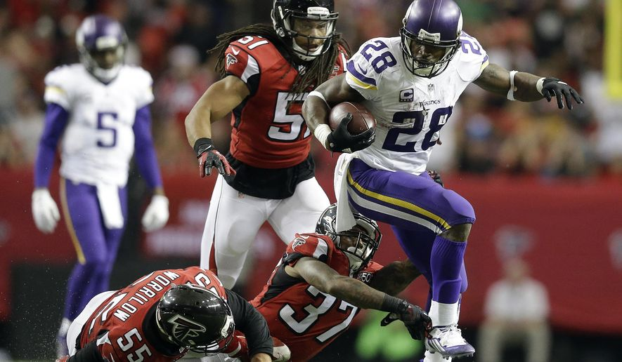 FILE - In this Nov. 29, 2015, file photo, Minnesota Vikings running back Adrian Peterson (28) runs against the Atlanta Falcons during the second half of an NFL football game in Atlanta. With Adrian Peterson again leading the NFL in rushing and fueling a low-turnover offense, a consistently stingy defense and solid special teams, the Vikings have been using a formula for success that's similar to the Seahawks even if it's an imperfect comparison.   (AP Photo/David Goldman, File