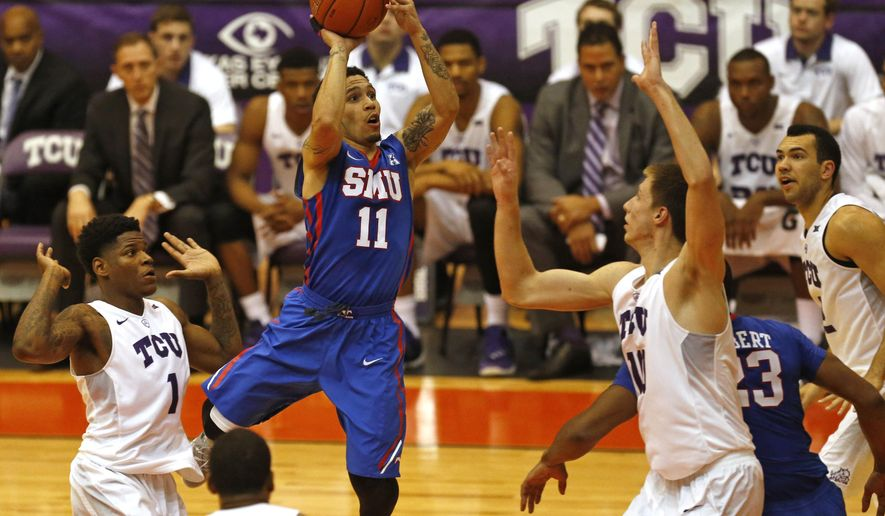 SMU guard Nic Moore (11) drives inside as TCU defenders Chauncey Collins (1), Malique Trent (3) and Vladimir Brodziansky (10) defend the basket during the first half of an NCAA college basketball game Wednesday, Dec. 2, 2015, in Fort Worth, Texas. (AP Photo/Ron Jenkins)