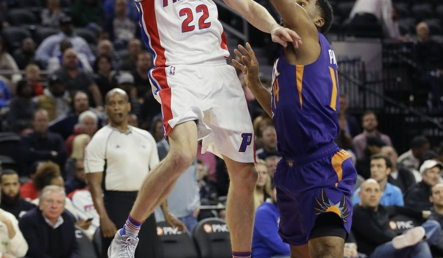 Detroit Pistons guard Steve Blake (22) shoots as Phoenix Suns guard Ronnie Price defends during the first half of an NBA basketball game, Wednesday, Dec. 2, 2015, in Auburn Hills, Mich. (AP Photo/Carlos Osorio)